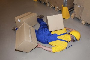 Warehouse worker after accident hit by cardboard